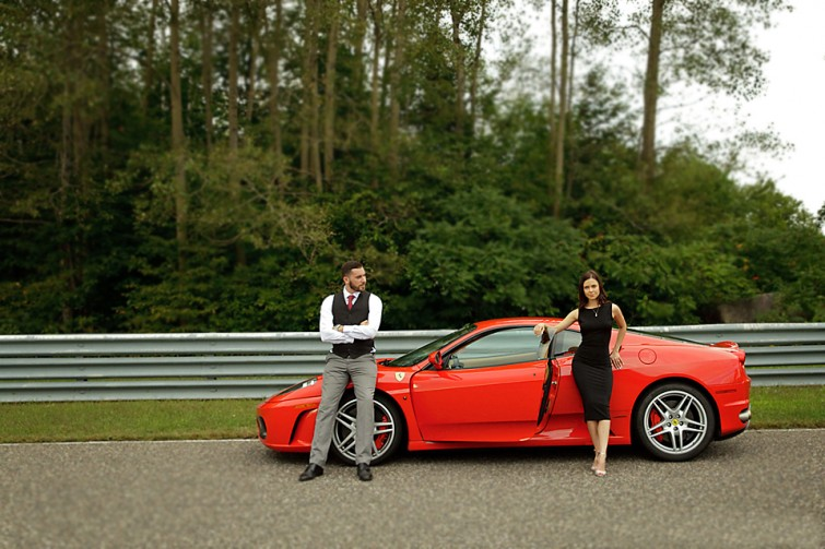 red ferrari couple standing engagement photo ideas
