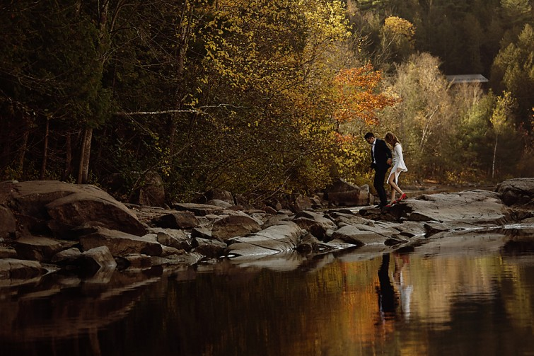 couple walking by water fall engagements